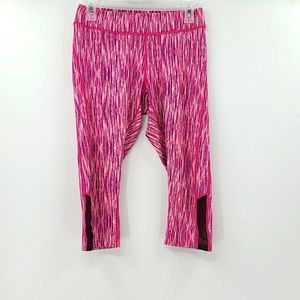 Reebok pink capri work out pants with mesh sides